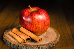 Red apple with cinnamon. Decoration Royalty Free Stock Photography