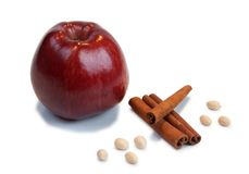 Red apple, cinnamon , peanut. Red Apple, cinnamon and peanuts, a good fruit set for mulled wine or a sweet pie Stock Photo