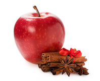 Red apple with cinnamon and star anise. Isolated on white Royalty Free Stock Photos
