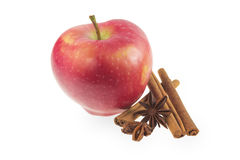 Red apple with cinnamon and star anise. On a white background Stock Photo
