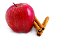 Red apple and cinnamon sticks. Shiny red apple and cinnamon sticks isolated on a white background Stock Images