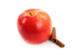 Red apple with cinnamon sticks. On white background Royalty Free Stock Photography