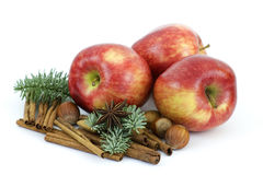 Red apple, cinnamon sticks, anise and nuts Stock Photo