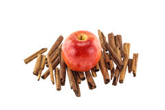 Red apple and cinnamon sticks Stock Photography
