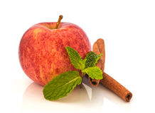Red  apple  with  cinnamon sticks  isolated on white background Stock Images