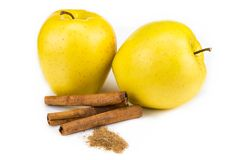 Red apple and cinnamon sticks isolated on white.  Stock Images