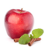 Red apple, cinnamon sticks and mint leaves still life. Isolated on white cutout Royalty Free Stock Photo
