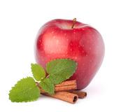 Red apple, cinnamon sticks and mint leaves still life Stock Photo