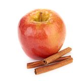 Red apple and cinnamon sticks Royalty Free Stock Photo