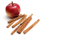Red apple and cinnamon sticks. On white background Royalty Free Stock Photos