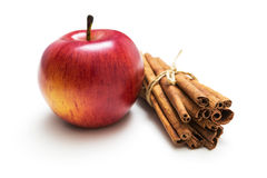 Red apple and cinnamon sticks. On white background Stock Photos