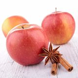 Red apple and cinnamon. On wood Royalty Free Stock Photography