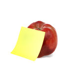 Red apple with clear yellow notepaper. Fresh red apple with yellow notepaper for your notes Stock Image