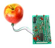 Red apple connected to the electric board Royalty Free Stock Image