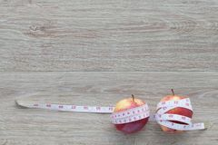 Red apple core and measuring tape.The concept of weight control Stock Photos