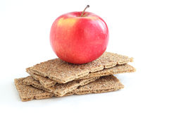 A red apple with crisp bread Royalty Free Stock Photos