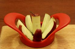 Red Apple cut and Cored. On a wooden cutting board royalty free stock images