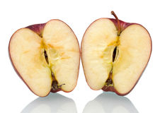 Red apple cut in half Stock Images