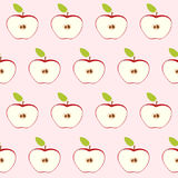 Red apple cut in half with core and seeds. Seamless retro pattern on light pink background. Flat style. Vector illustration. Royalty Free Stock Images