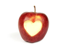 Red apple with cut out heart. Single red apple with a heart cut out in the center Stock Image