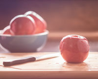 Red apple on cutting board Stock Photography