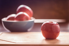 Red apple on cutting board Stock Image
