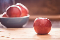 Red apple on cutting board Royalty Free Stock Image