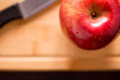 Red apple on cutting board Royalty Free Stock Photo