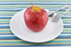 Red apple on dish concept for healthy diet and body weight con Royalty Free Stock Images