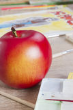 Red apple and drawing Royalty Free Stock Images
