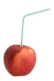 Red Apple with Drinking Straw. Juice concept royalty free stock photos