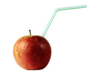 Red apple with drinking tube Stock Images