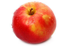 Red apple and a drop of water Royalty Free Stock Images