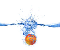 Red apple dropped into water Royalty Free Stock Image