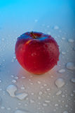 Red apple with drops Royalty Free Stock Photography