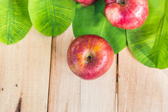 Red apple on dry wood Stock Photos