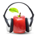 Red apple in earphones Royalty Free Stock Images