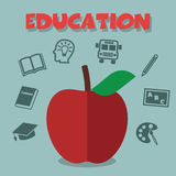 Red apple with education icons Royalty Free Stock Photography