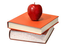 Red apple and educational science textbooks. Food for the body and mind royalty free stock photography