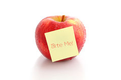 Red apple with empty post-it, Bite me ! Stock Photo