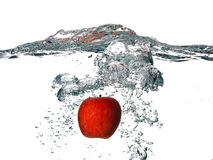 Red Apple Falling into the Fresh Water Isolated on White Backgro Stock Images