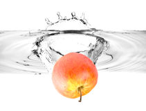 Red apple falling into water Royalty Free Stock Images