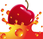 Red apple falls in juice Royalty Free Stock Photography