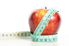 Red apple fitnes concept with centimeter. Stock Photography