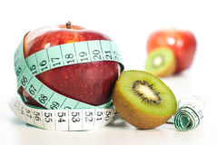 Red apple fitnes concept with centimeter. Royalty Free Stock Photography