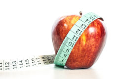 Red apple fitnes concept with centimeter. Stock Images