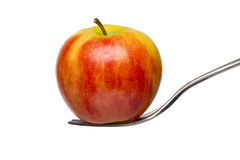 An red apple on a fork Stock Images