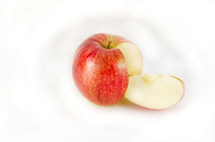 Red apple and a fragment on a white background. Red apple and slice isolated on white background Royalty Free Stock Photo