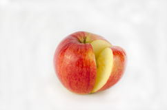 Red apple and a fragment on a white background Royalty Free Stock Photos