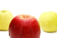 Red Apple in front of Yellow Royalty Free Stock Image